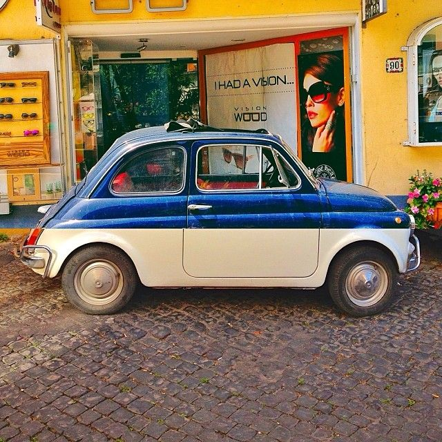 Classic Fiat 500 | black on top, white on bottom, bright green narrow stripe between the two