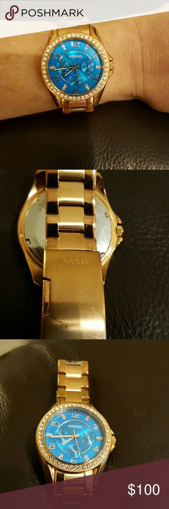 Fossil Watch Fossil Watch with blue face surrounded by crystals. Analog with odd numbers each represented by crystals.    Works but needs battery.   Go to any Fossil store for FREE LIFETIME BATTERY REPLACEMENT.   Gold tone. Accessories Watches