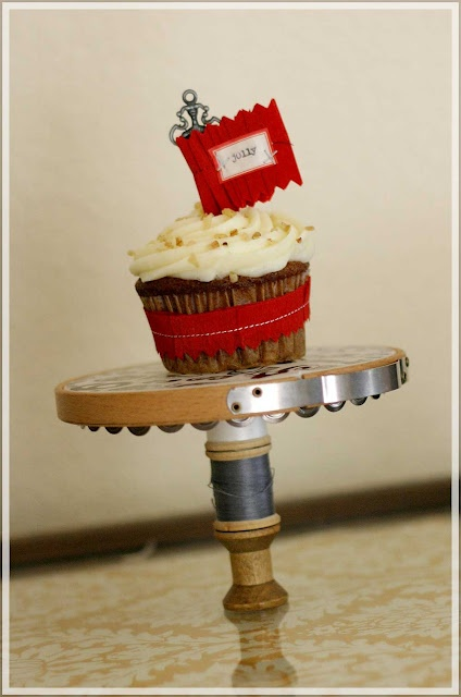 cupcake stand is made with a vintage embroidery hoop