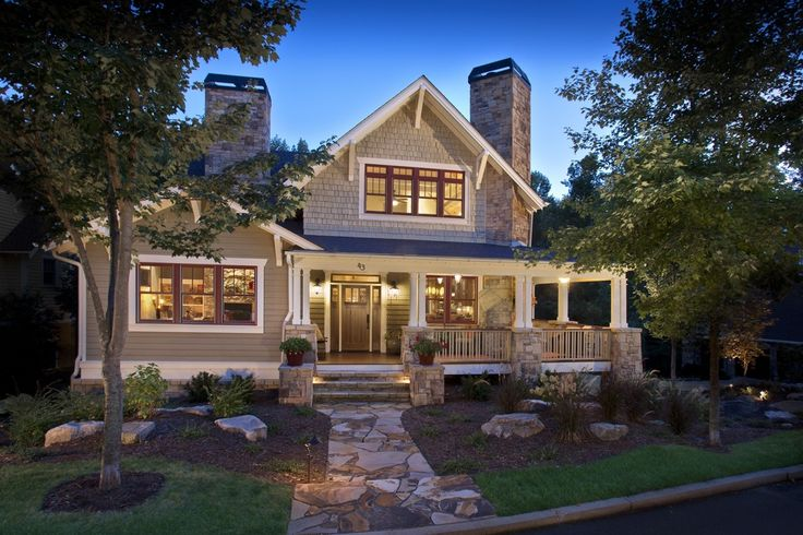 Craftsman Exterior of Home with Paint, double-hung window, Covered front porch, Natural stone pathway