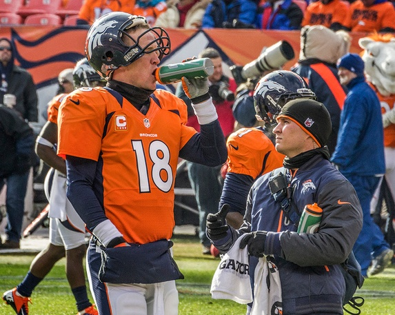 Peyton Manning taking a drink during the AFC Divisional playoff game.