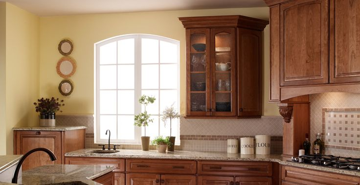 Can keep cabinet color; paint, backsplash, counter, floors (paint the linoleum a medium gray to complement the countertop?)