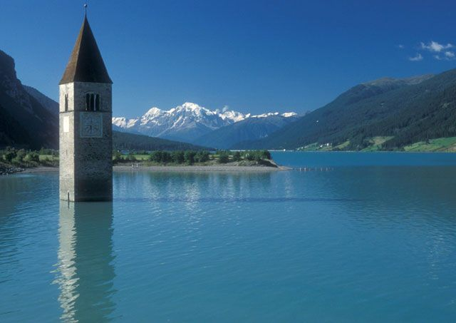 Curon Venosta, Italy.  The Bell Tower is the only reminder of this town that was flooded to create an artificial lake.