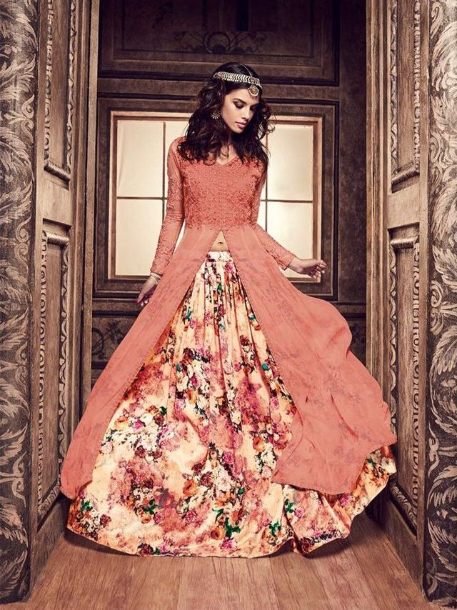 Buy Peach and cream color pure silk floral lehenga style party wear kameez at kollybollyethnics with free worldwide shipping.