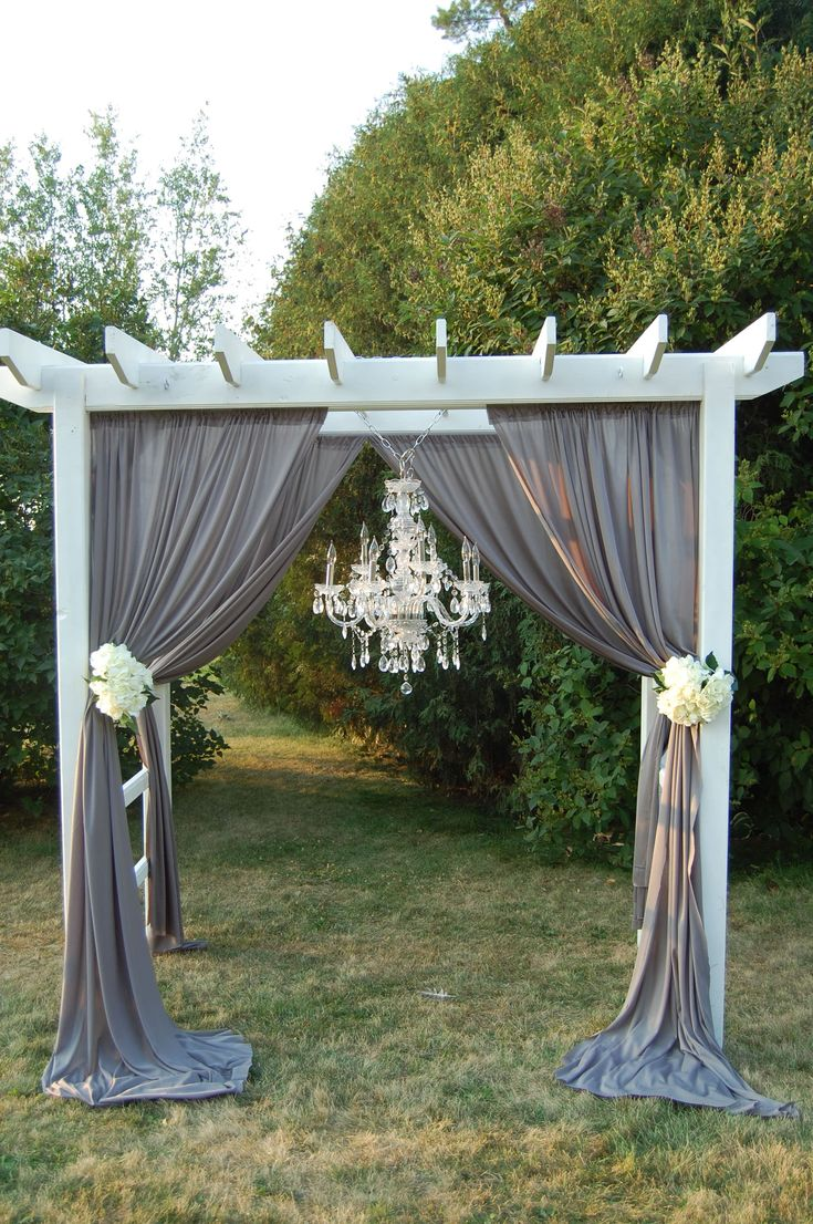 Best 25 wedding pergola ideas on pinterest wedding archway diy ceremony pergola with chandelier and draping arubaitofo Choice Image