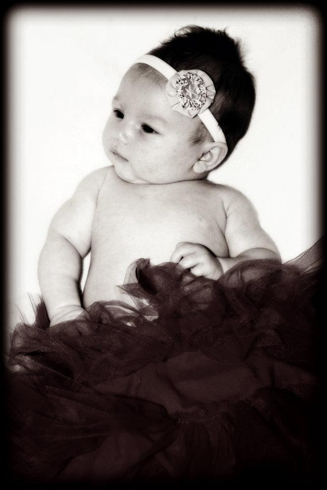 what a sweetie.. wearing a little stretch head band by Evee Apparel find one like this at www.facebook.com/eveeapparel