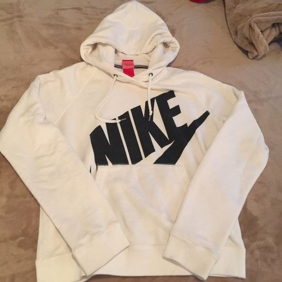 White Nike pullover hoodie Good condition size medium Nike pullover hoodie white with black symbol. Nike Sweaters