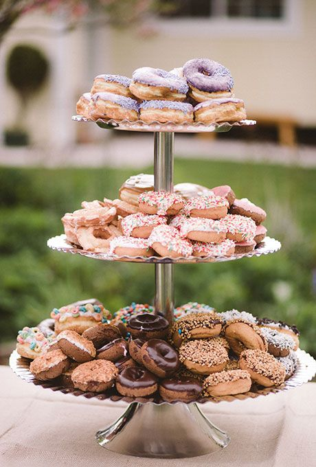 Frosted donuts by Voodoo Donuts as a wedding dessert | Brides.com