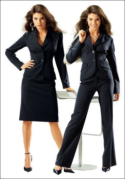 Business professional attire for women includes a skirt suit or pant suit in neutral tones -- black, brown, gray or navy. Pants should be full length -- avoid crops or capri pants -- and skirts should hit at the knee.