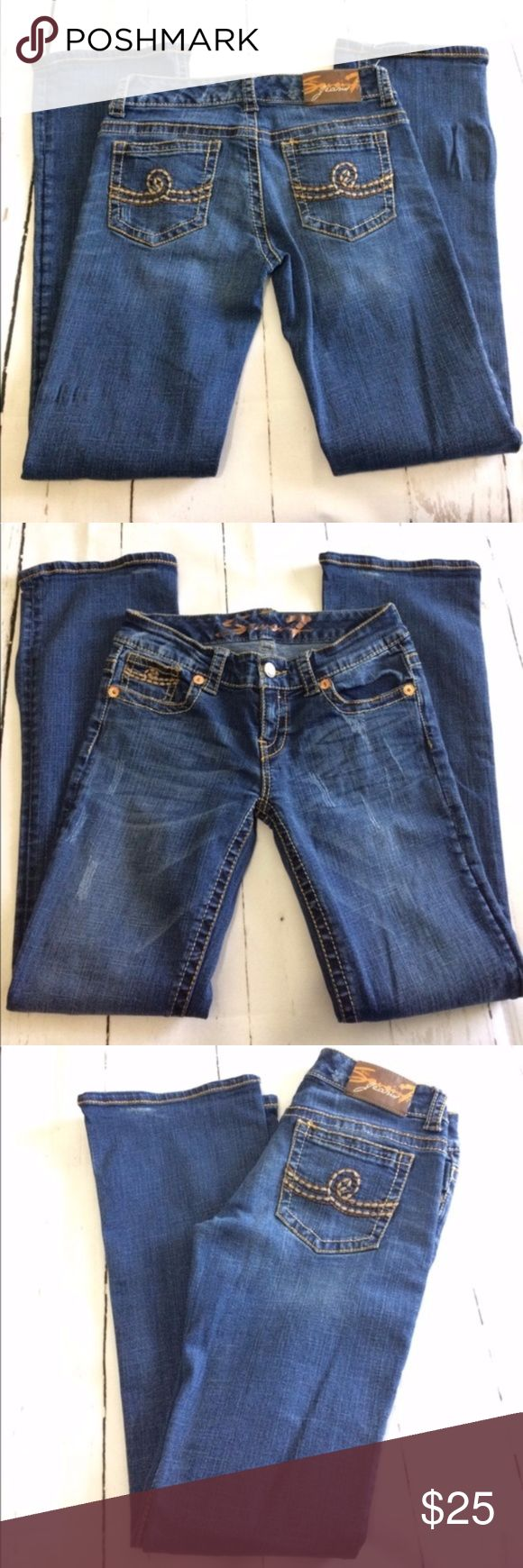 Seven7 Distressed Women's Jeans Brand: Seven7  Description: Manufactures distressed. Bootcut  Three front pockets. Two back pockets. Gently worn.  Rise: 8 inches  Inseam: 31 inches  Size: 28 Seven7 Jeans Boot Cut