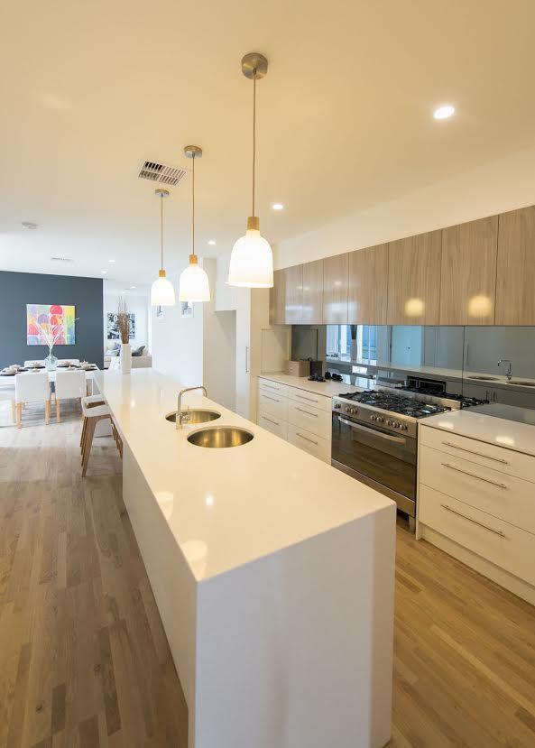 The Cezanne 290 Display by Gallery Living Homes SA #weeklyhometrends #kitcheninspo #design #styling #homedecor #timberfloorboards #whitebenchtop #pendantlights #timberandwhite #kitchen #clark #gallerlivinghomes http://galleryliving.com.au/cezanne-290/