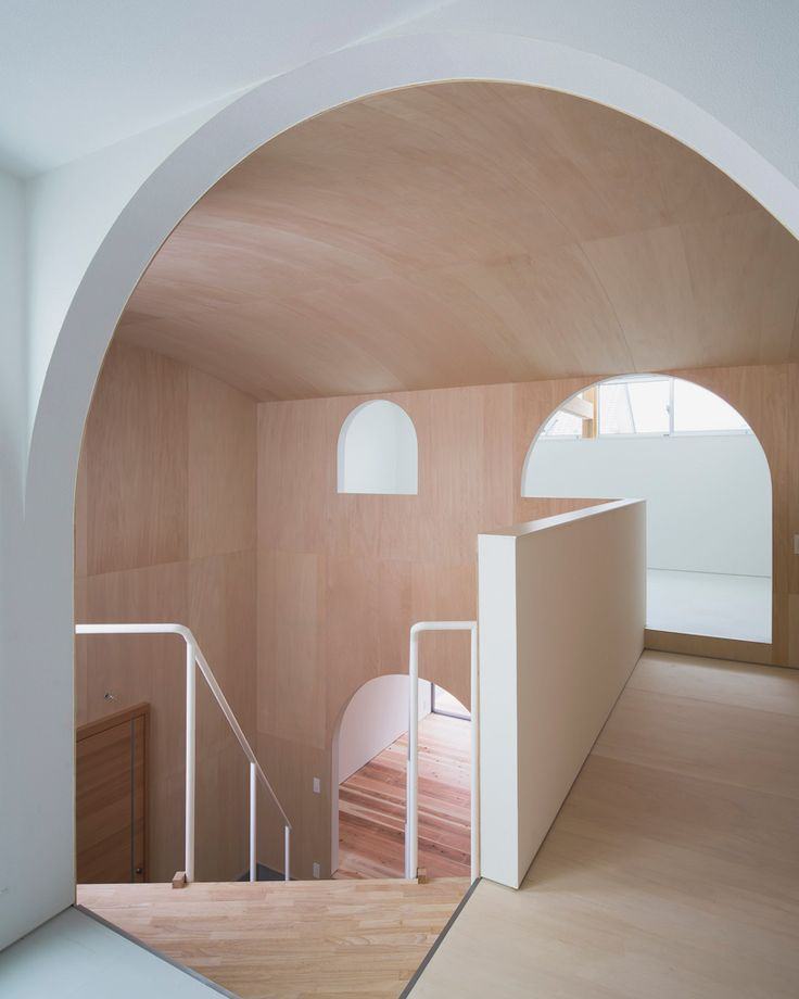 Artful arches in a home created by Container Design in Kudamatsu, Japan