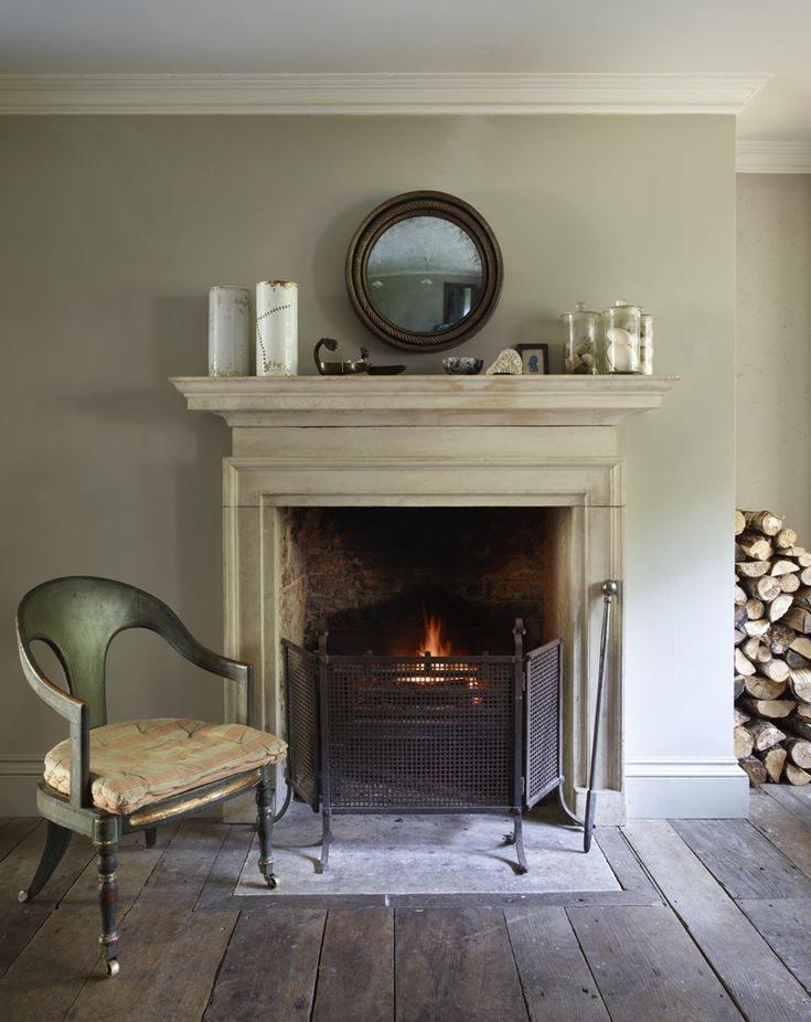 All about matter: wood, painted plaster, calcimated paint, stone, the wall color looks a bit like Farrow and Ball's French Gray.