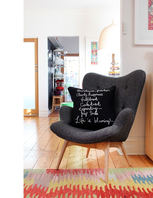 Jane Hall's Melbourne home on The Design Files. Love that grey armchair.