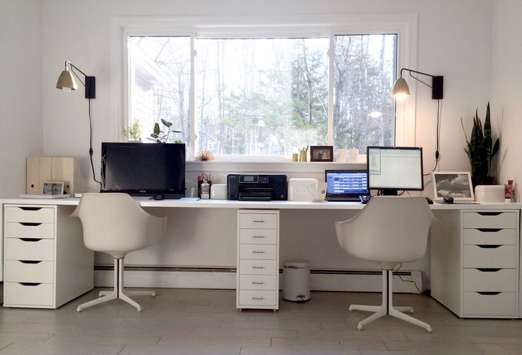 Ikea hacked faux built-ins double desk. Love the sun-filled & fresh Nordic style office!