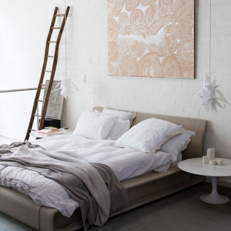 soothing neutral bedroom/ Big ass piece of art above. This is my dream city loft bed.