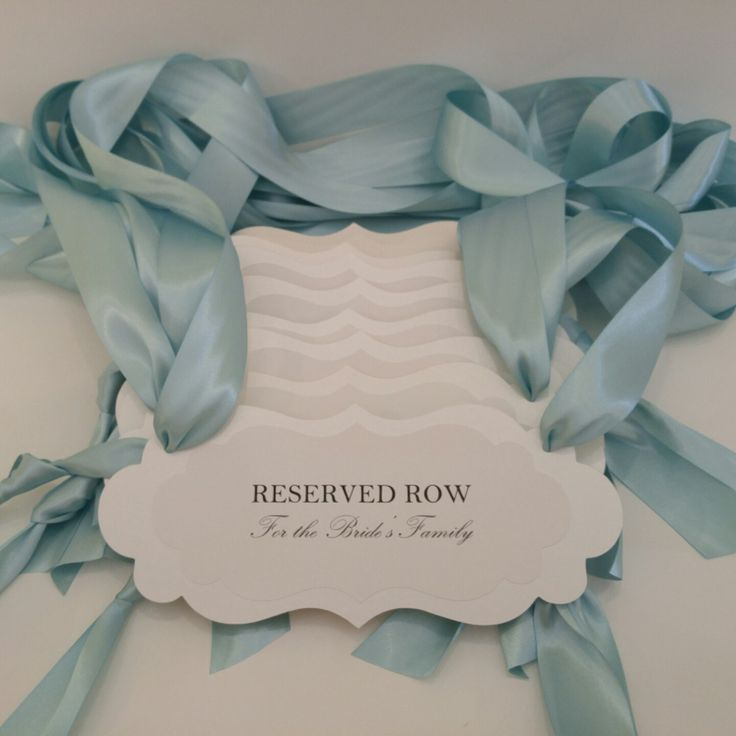 #wedding pew sign to reserve rows for family and special guests. Colors are shimmery white backing, white, pool blue ribbon. Gorgeous.