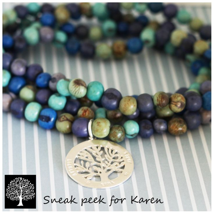 Blue mix acai seed necklace with my family tree pendant.