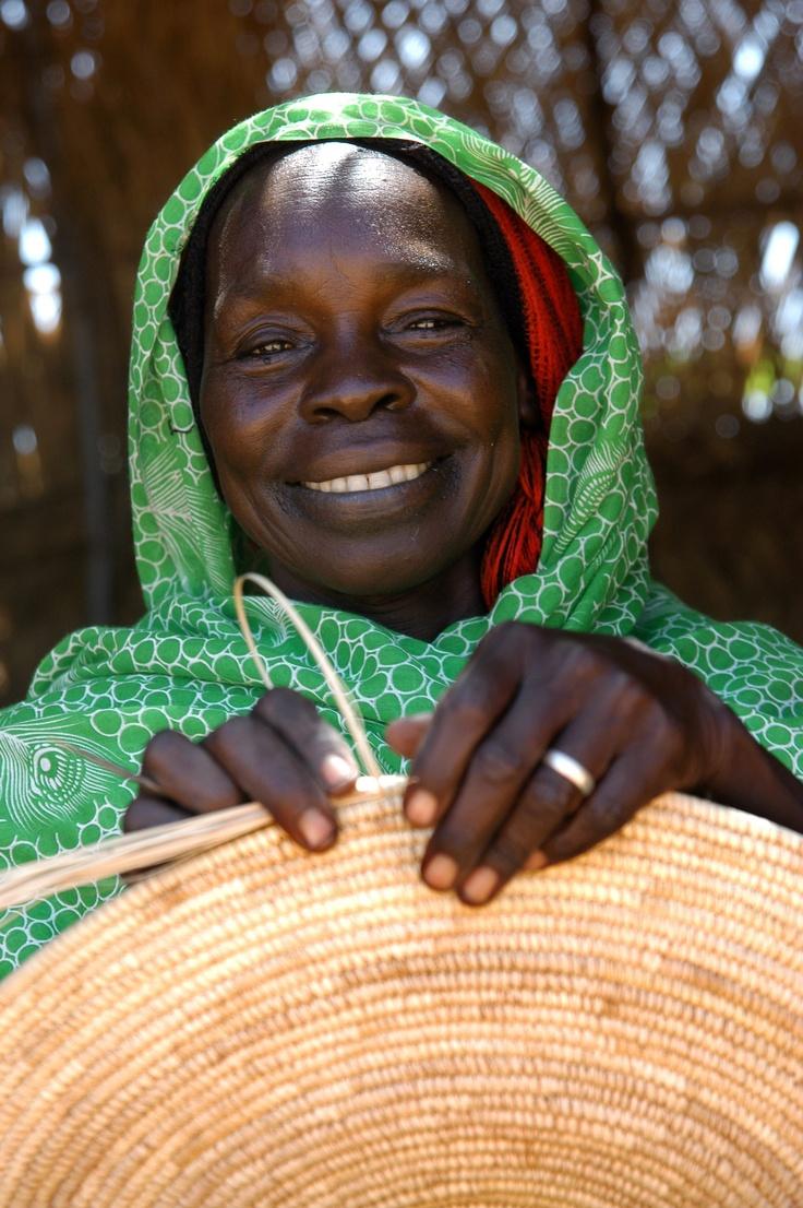 Woman doing handicraft at the center in Ryad camp, El Geneina, West Darfur.  UNHCR/ H. Caux