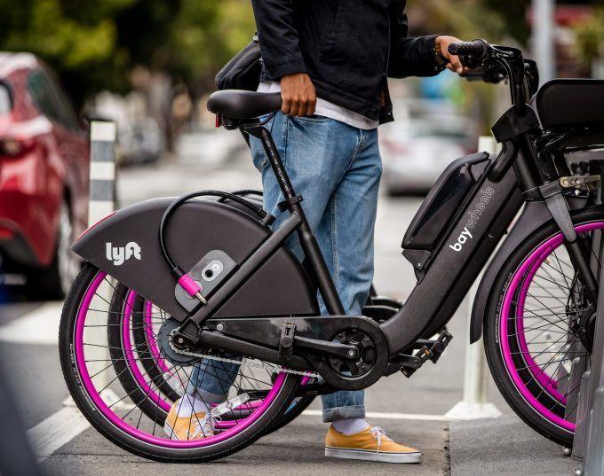 Lyft Deploys Its Pink Wheeled Bikes And Rebrands Ford Gobike As Bay Wheels New Electric Bike Bike E Bike Battery