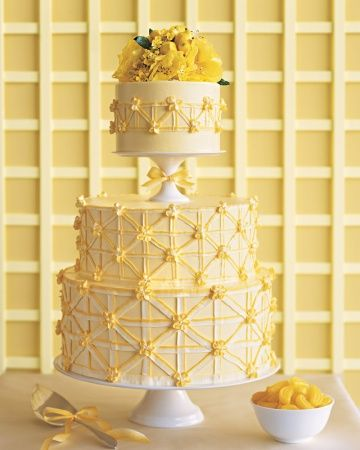 Perfect Piping Wedding Cake. This patterned lemon cake features piped flowers where every band meets. The floral topper is an added bonus—but you can sub in a traditional topper, too.