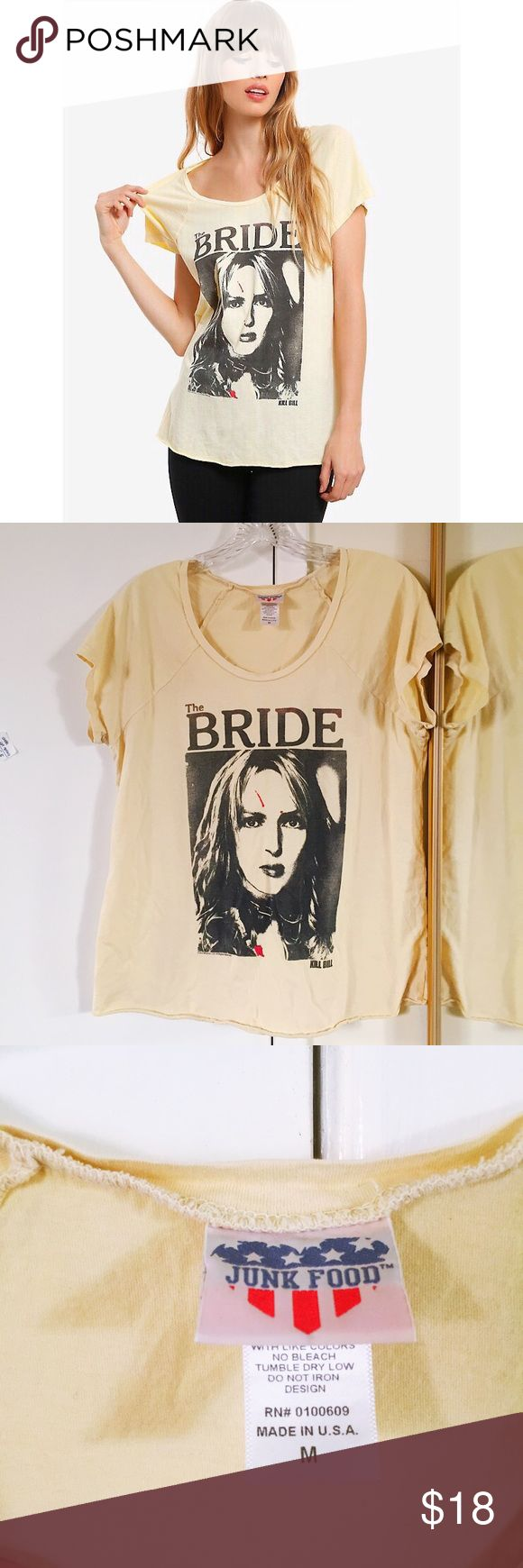 "Junk Food Kill Bill ""The Bride"" tee-shirt Quentin Tarantino fan? Your fangirl needs a badass Bride tee-shirt! This super soft 100% cotton shirt is banana yellow (closer to my photos than the stock image) and generously cut for a slightly slouchy fit, easily accommodates M - XL. Uma's character has a little blood splattered on her face, but not to worry, there are no notable flaws on the shirt. Excellent used condition, purchased from Box Lunch. Junk Food Tops Tees - Short Sleeve"