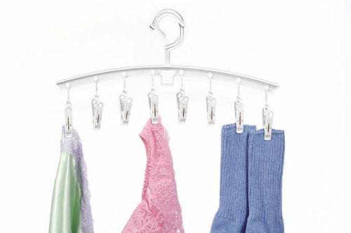 "Set of three, ""clip 'n drip"" hangers"