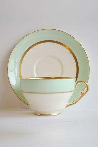 My vintage dishes I got as a gift for my wedding look like this but the gold is a scrolling leaf pattern.