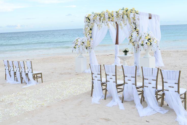 Elegant white and yellow ceremony on the Beach here at Dreams Tulum Resort & Spa! #DreamsTulumWedding #DreamsWedding #DestinationWedding #WhiteWedding #WeddingInspo #BeachCeremony