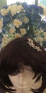 Curved  flower motif  crystal headpiece on comb