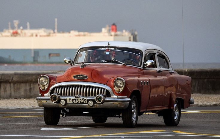 An American classic car drives along Havana's waterfront, on March 19, 2016. Political and economic reforms in Cuba will be a no-go area during talks between Cuban leader Raul Castro and US President Barack Obama, Cuban Foreign Minister Bruno Rodriguez said Thursday. Obama will be on Sunday the first sitting US president to visit Cuba since 1928, capping his historic policy of ending a bitter standoff that has endured since Fidel Castro's overthrow of the US-backed government of Fulgencio…