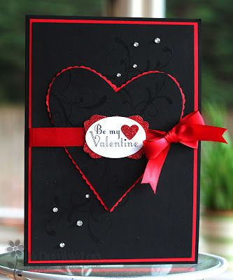 handmade Valentine card ... embossed black background ...  red ribbon with perfect bow ... underlayers show in just a hint of a red outline ...