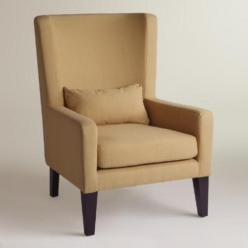 Our high back armchair in warm beige delivers the style of a vintage chair updated with the modern practicality of a solid build. Mix one in with your living furniture to make a scene-stealing statement, or group several around a low table for a high-impact effect.