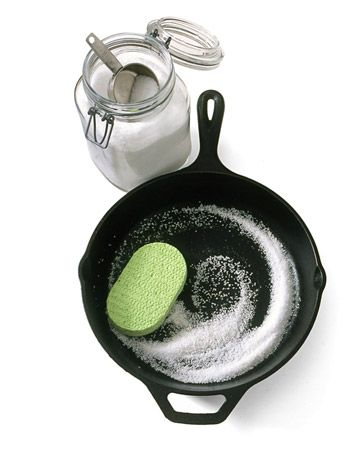 To clean a cast iron skillet, scrub it with coarse salt and a soft sponge. The salt, a natural abrasive, absorbs oil and lifts away bits of food while preserving the pans seasoning. Rinse away salt and wipe dry.