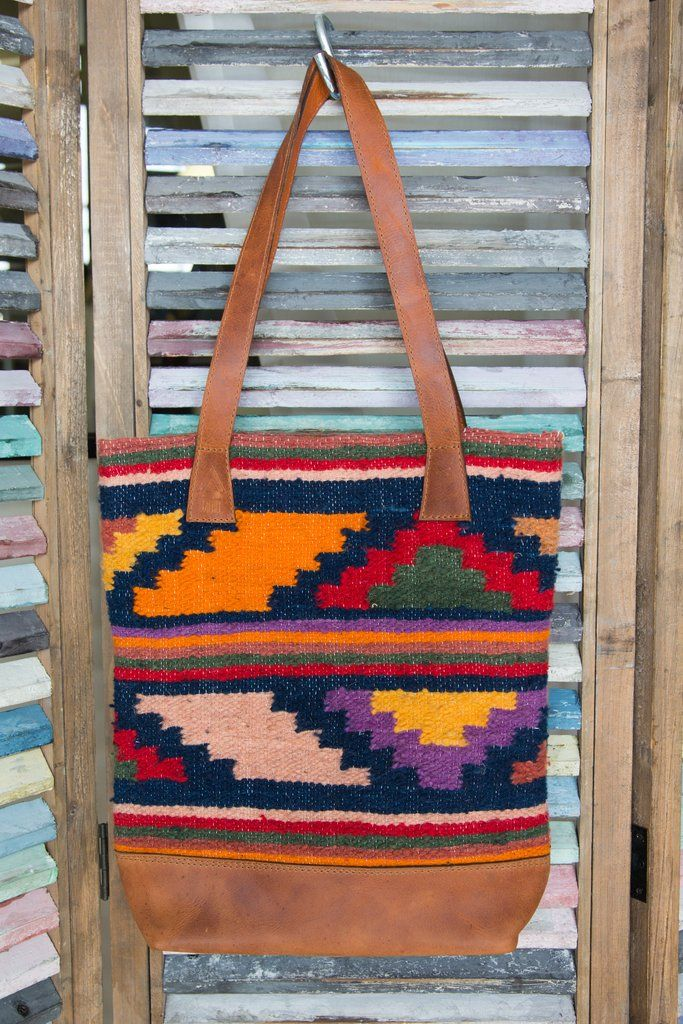 Our Kolom Tote is made from handmade woven Mayan Rugs and is trimmedwith the highest quality genuine full hide leather. Our leather is natural and untreated. I