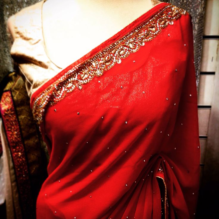 Feel the warmth in this glorious red georgette saree with gold embellishment!