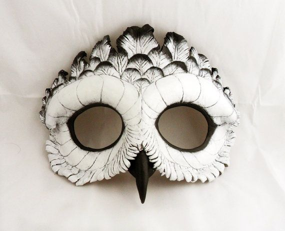 This mask is made of 2 layers of 6 oz veg-tanned leather which has been hand-molded, carved, and painted to create a detailed Snowy Owl.