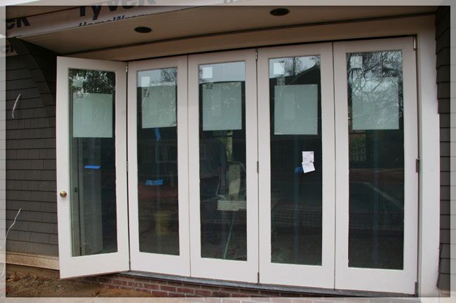 Instead of doing french doors - consider bifold glass doors. Nice for great weather days to bring the outside in!