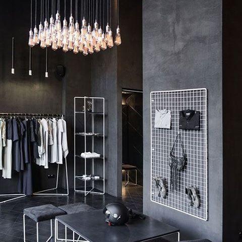 #Kiev- @podolyanbrand #store - Retailand #Retail #Design. #fashion #brand #boutique . #interior #interiordesign. #black #clothes #table #lighting #lights