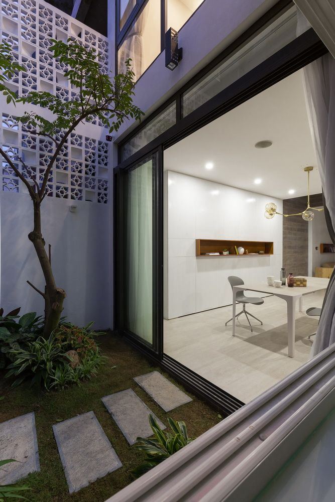 Landmak Architecture's simple redesign turned an ordinary row house into the most modern home in the neighborhood.