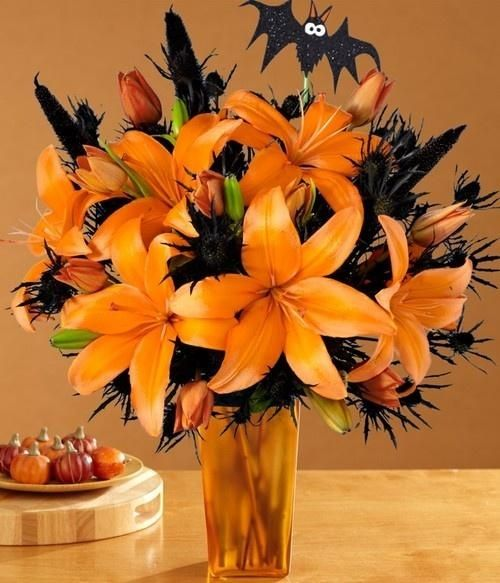 What a great idea for Halloween! Orange Asiatic Lilies pair perfectly with Eryngium for a spooky spider look! Shop Asiatic Lilies and Eryngium year-round at GrowersBox.com!: Flowers Bouquets, Halloween Decor, Bats, Halloween Arrangements, Beautiful Halloween, Centerpieces, Halloween Floral, Fall Flowers Arrangements, Halloween Flowers