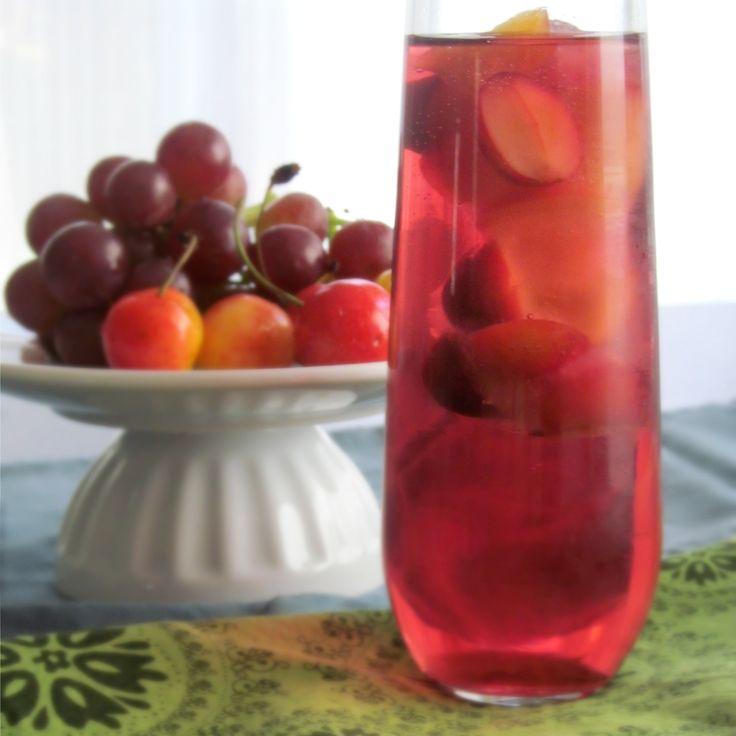 Grape spritzer with frozen fruit cubesFrozen Fruit, Grape Sangria, Ice Cubes, Electric Grape, Fruit Cubes, Sangria Recipe, Sangria Fizz, Grape Juice, Drinks Recipe