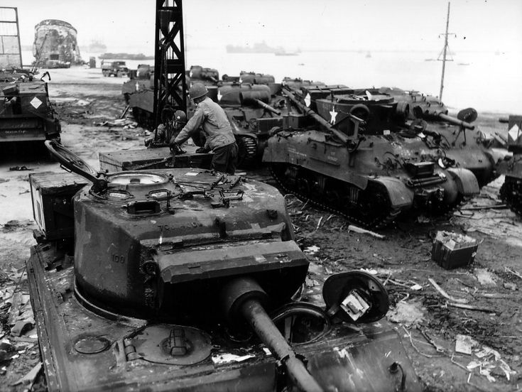 American Soldiers M4A3E2 Sherman Jumbo. Tank M4A3E2 Sherman Jumbo - Assault variant tank M4A3 (75) W On the second plane armored repair machine M32 to M4A3 tank chassis. For 'Sherman' various modifications.