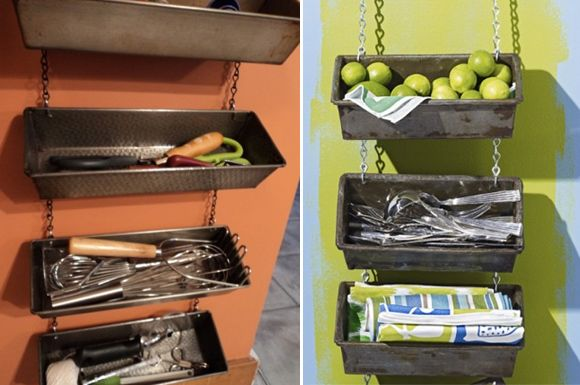 Old loaf pans repurposed as hanging organizers. Easy DIY project. (If one didn't want to bother with chains, small brackets could be used underneath to attach them to the wall.)