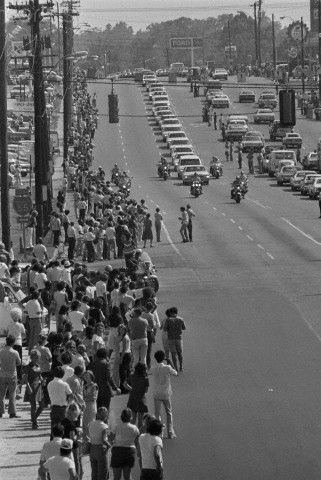 People Lining the Street for Elvis' Funeral   Memphis, TN: Thousands of people stand on the sidewalk and in the street to watch the funeral procession of Elvis Presley August 18, 1977.