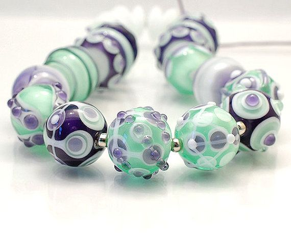 sweet ink blue and pale emerald green lampwork bead set by clo beads on etsy