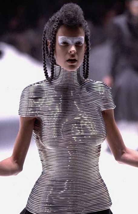 Coiled corset : Laura Morgan wearing the metal bodice on the McQueen catwalk made by Shaun Leane . Studio van der Graaf had made a solid plaster body cast so it fitted her body perfectly . © alexander mcqueen, 1999 .