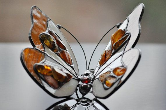3D Amber & Stained Glass Butterfly - beautiful stained glass suncatcher made with Tiffany technique. The butterfly is decorated with natural Baltic amber. It has special hook to hang on a wall. It is also possible to make special hooks to hang it from a ceiling. Very special mothers day gift.  See other related suncatchers: Personalized butterfly - https://www.etsy.com/listing/120157553/personalized-butterfly-stained-glass 3D stained glass butterfly…