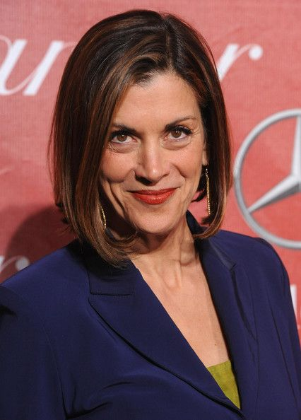 Wendie Malick in the perfect shade of navy and a chili-red lip.