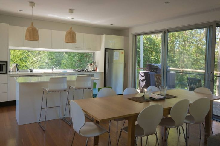 House in Smiths Lake, Australia. Secluded architect designed treetop retreat designed as the perfect holiday getaway - ideal for friends and family. Fully equipped and family friendly, incorporating 4 bedrooms, 3 bathrooms, 2 separate living areas all with stunning views.  A trul...